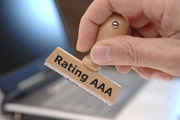 "Hand stamping a document with a stamp bearing the terms ""Rating AAA"""