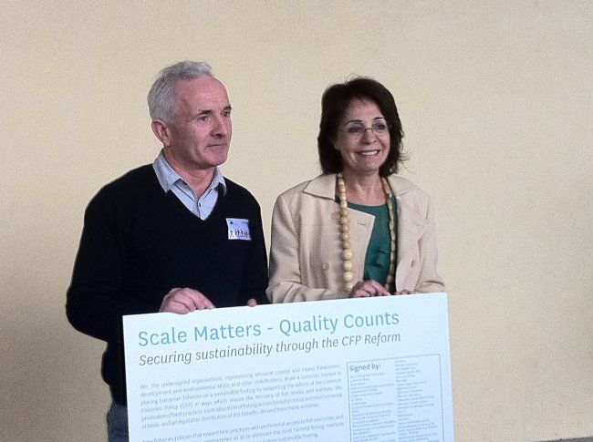 "Representatives from small-scale fishermen organisations present the declaration ""Scale Matters - Quality Counts"" to Commissioner Maria Damanaki"