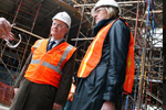 Karel De Gucht, on the left, visits construction site of new North American Headquarters for Porsche
