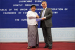 Handshake between Win Aung, Chairman of the Union of Myanmar/Burma Federation of Chambers of Commerce and Industry (Umfcci), on the left, and Karel De Gucht