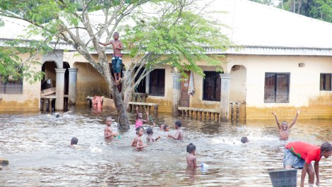 Children make the most of slowly receding flood waters in Nigeria © ShelterBox
