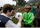 Commissioner Georgieva hands out donated soccer balls to the local chairman in Kitutu (c) EU