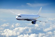 Airplane in sky © iStockphoto