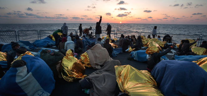 Migrants on the Mediterranean from Pakistan, Sudan, Syria and other countries, aboard an Italian naval vessel. Photo: UNHCR / A. D'Amato