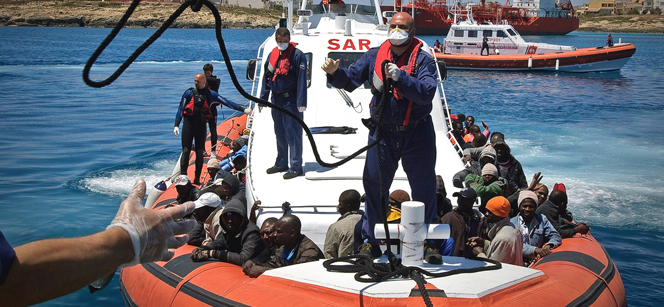 May 2011: An Italian Coastguard boat approaches Lampedusa, Italy, to disembark 142 migrants, including 30 women and three children. Photo: F. Noy/UNHCR