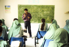 Teacher talking to his students in North Pakistan
