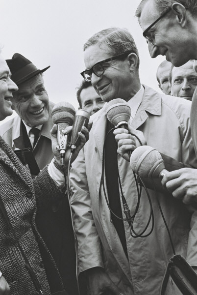 Jean Rey, returning from Geneva, greeted by journalists on his arrival