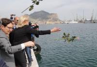Corina Cretu launch a flower in the see