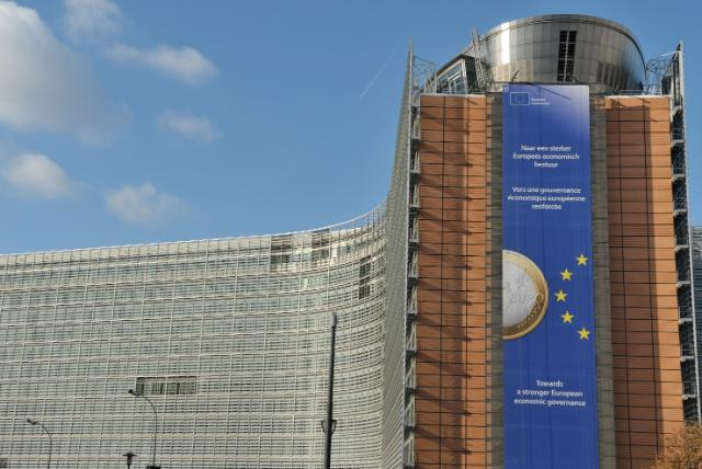 Banner at the EC Berlaymont's frontage with the inscription Towards a stronger European economic governance