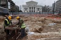 Field archaeologists looking for artifacts in the excavation site where the new metro station will be constructed, at Municipal Theater (Dimotiko Theatro)