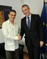 Andris Piebalgs, right,  greets Ecuadorian Minister of Foreign Trade Francisco Rivadeneira