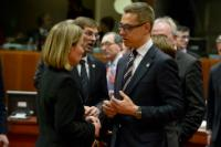 Discussion between Alexander Stubb, Finnish Prime Minister, and Federica Mogherini (in the foreground, from right to left)