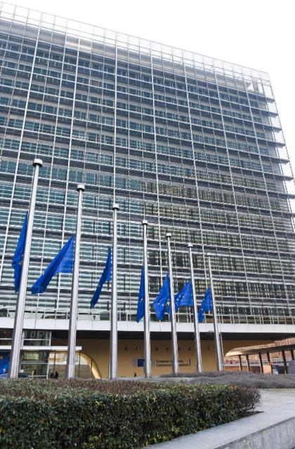European flags fly at half-mast in front of the Berlaymont, in tribute to victims of the attack in Denmark