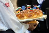 Bulgarian bread pierced with the Bulgarian, German and European flags