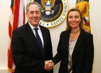 Handshake between Michael Froman, on the left, and Federica Mogherini