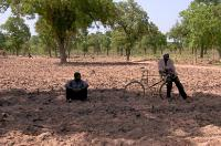 A farmer leaning on his bicycle, in his field in Ouelessebougou, in the region of Ségou. Following 2012 poor rainfall, farmers of this region receive support from a joint programme operated by the EU and the World Food Programme (WFP), allowing farming activities to resume.