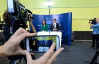 Cecilia Malmström, on the left, and Michele Cercone, her Spokesperson, seen through the screen of a smartphone