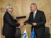 Exchange of signatures between Philippe Le Houérou, on the left, and Neven Mimica