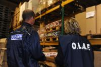 OLAF investigator and Belgian Customs inspector in a warehouse of smuggled cigarettes
