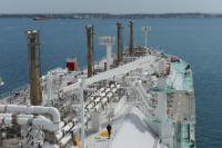 The arrival of an LNG (Liquefied natural gas) tanker in the Port of Fos-sur-Mer, France