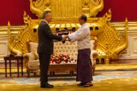 U Thein Sein, President of Myanmar/Burma, on the right, offering a gift to Karel De Gucht