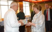 Feliciano Jr. R. Belmonte, giving a gift box to Catherine Ashton, in the presence of Miguel Ceballos Baron, Member of his cabinet (in the foreground, from left to right)