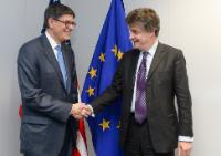 Handshake between Jack Lew, on the left, and Jonathan Hill