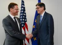 Handshake between Jack Lew, on the right, and Jyrki Katainen