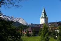 Schloss Elmau, with the national emblems of the 7 countries Members of the G7 and the European emblem, in the foreground, and the mountain, in the background