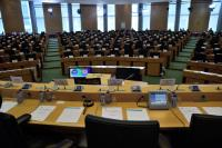 The hearings' room, almost empty