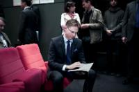 Jyrki Katainen, seated, in the centre, reading a document