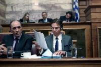 Giorgos Stathakis and Jyrki Katainen, reading a document (in the foreground, from left to right)