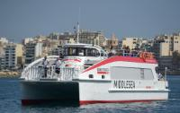 A ferry boat arriving in Valletta Harbor