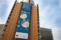 The Berlaymont building with the a poster announcing the entry of Estonia into the euro area