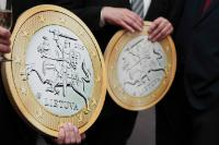 Two giant false 1 Euro coins at the effigy of Lithuania