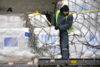 A worker unloading humanitarian aid from the Boeing 737 cargo