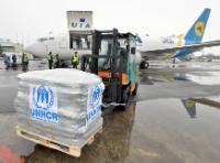 Servicemen of the Ukrainian State Service for emergency situation unloading the humanitarian aid