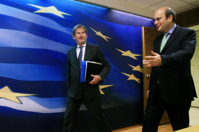 Kostis Hatzidakis, on the right, and Johannes Hahn