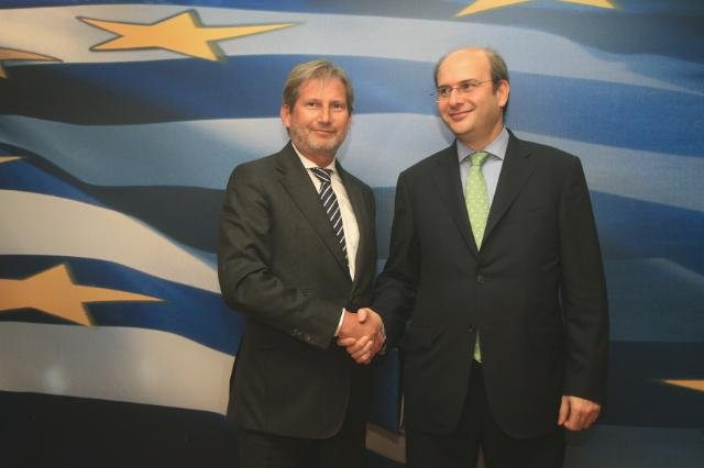 Handshake between Kostis Hatzidakis, on the right, and Johannes Hahn