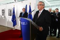 José Manuel Barroso, on the left, listening to the speech by Jean-Claude Juncker, at the podium
