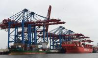 A containership and the container terminal of the Port of Hamburg