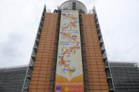 The Berlaymont building with the poster :