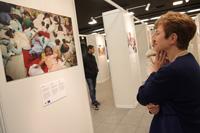 Visite par Kristalina Georgieva, membre de la CE, de l'exposition de photographies annuelle du PAM