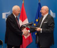"""Illustration of """"Initialling ceremony on the landmark tax transparency agreement between the EU and Switzerland"""""""