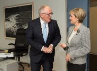 Discussion between Julie Bishop, on the right, and Frans Timmermans