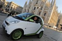 Antonio Tajani aboard an electric car