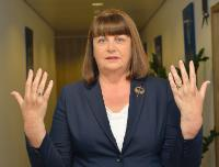 Màire Geoghegan-Quinn, showing the sign of number 10 with her fingers