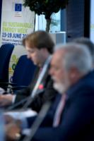 In the background: the poster of the European Sustainable Energy Week 2015 - EUSEW 2015