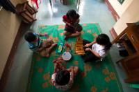 Children playing the xylophone and percussion (music therapy)