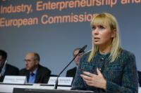 Giuseppe Aridon, Senior Vice-President for Marketing and Sales of Telespazio, and Denis Roger, Director for European Synergies and Innovation (ESI) at the European Defence Agency (EDA), listening to the speech by Elżbieta Bieńkowska, at the podium (from left to right)